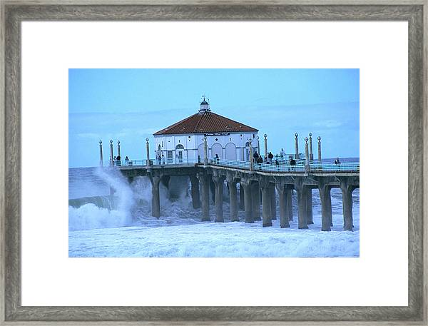 Waves Breaking Into The Pier At Framed Print
