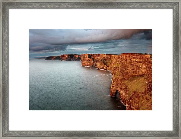 Waves Washing Up On Rocky Cliffs Framed Print