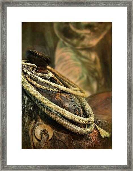 Western Style Saddle And Cowboy Framed Print