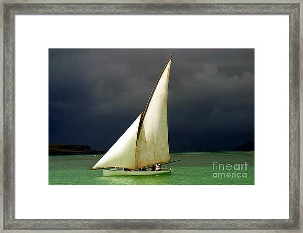 White Sailed Pirogue On The Ocean Framed Print