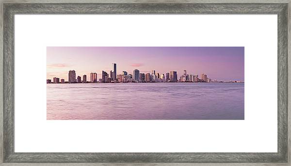 Wide View Of City And Water At Sunset Framed Print