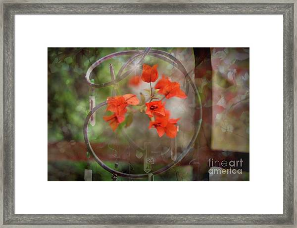 Wind Chimes Through The Window Framed Print