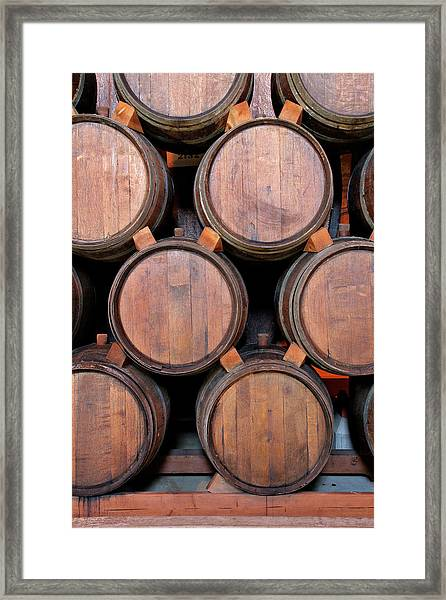Wine Barrels Stacked Inside Winery Framed Print