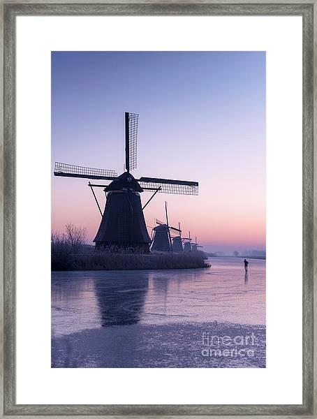 Winter Skater Framed Print