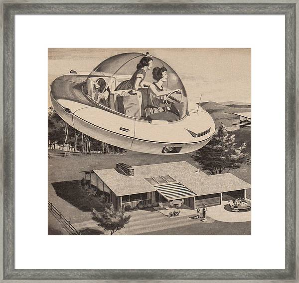 Woman Driving Flying Saucer Framed Print