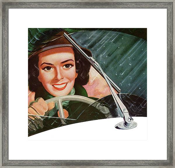 Woman Driving In Rain Framed Print
