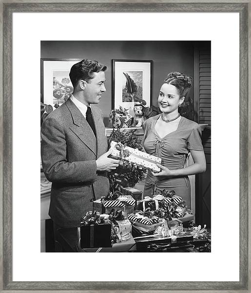 Woman Giving Gift To Man, B&w Framed Print by George Marks
