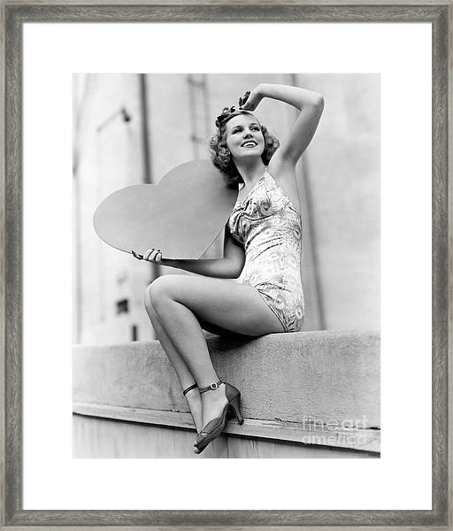 Woman Holding A Large Valentine Framed Print