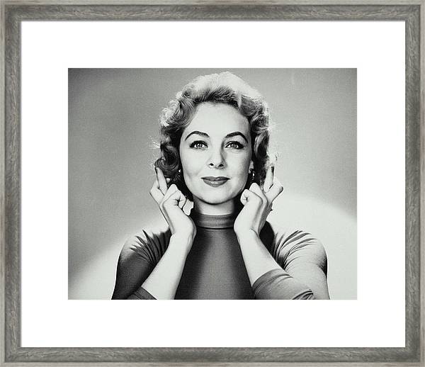 Woman Holding Up Crossed Fingers To Her Framed Print