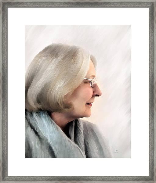 Woman In Grey Framed Print