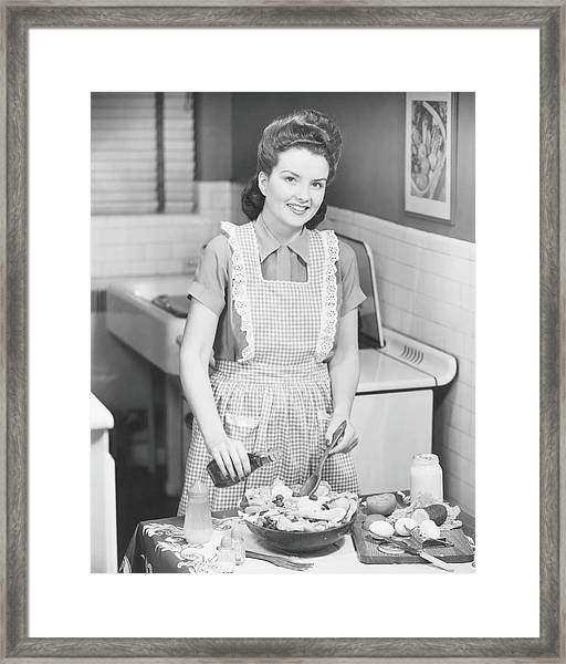 Woman Preparing Salad In Kitchen , B&w Framed Print by George Marks