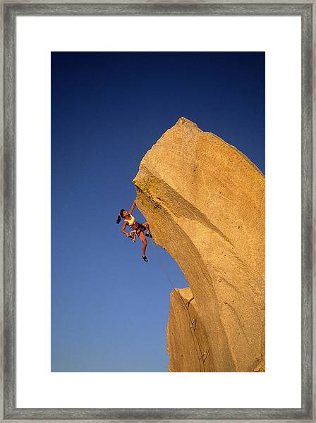 Woman Rock Climber Climbing Cliff Wall Framed Print