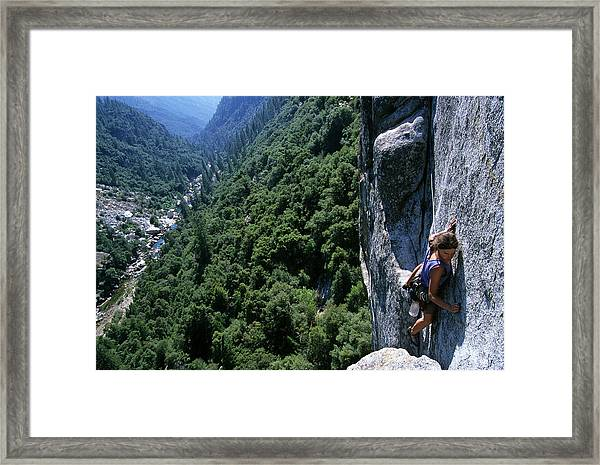 Woman Rock Climbing High Above River Framed Print by Heath Korvola