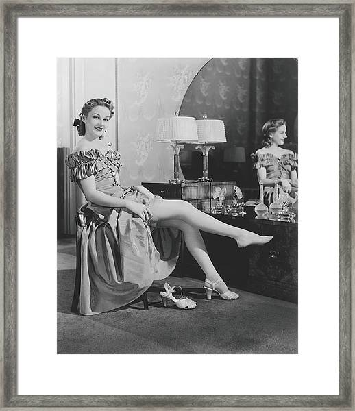 Woman Sitting At Vanity Table, Putting Framed Print by George Marks