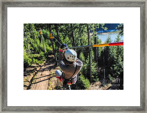 Woman Sliding On A Zip Line In An Framed Print