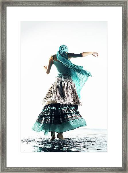 Woman With Feet In Water Framed Print