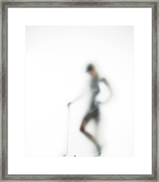 Woman With Golf Club Defocussed Framed Print
