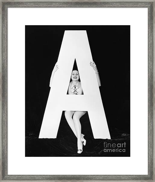 Woman With Huge Letter A Framed Print by Everett Collection
