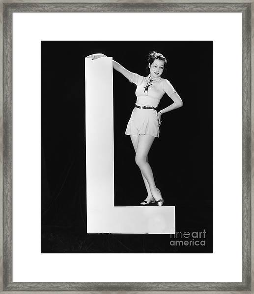 Woman With Huge Letter L Framed Print