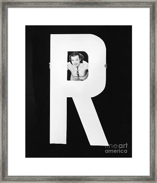 Woman With Huge Letter R Framed Print