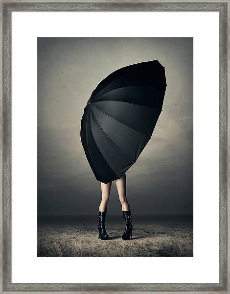 Woman With Huge Umbrella Framed Print
