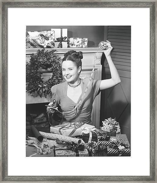 Woman Wrapping Christmas Presents In Framed Print
