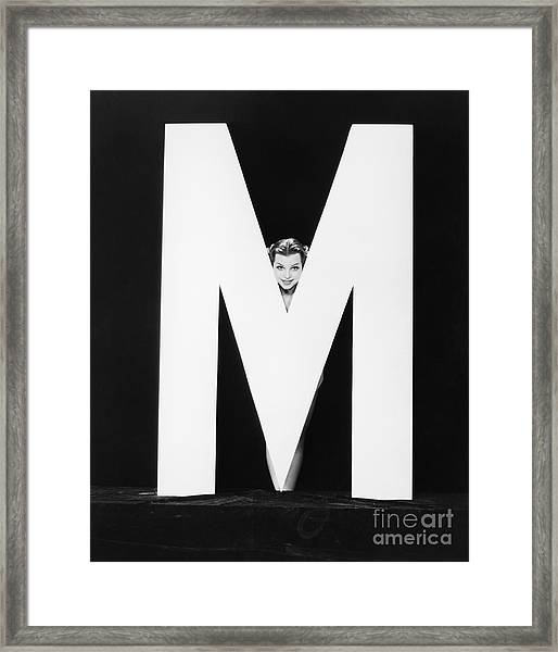 Womans Face With Huge Letter M Framed Print by Everett Collection