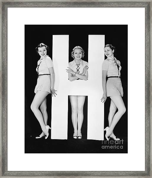 Women Posing With Huge Letter H Framed Print