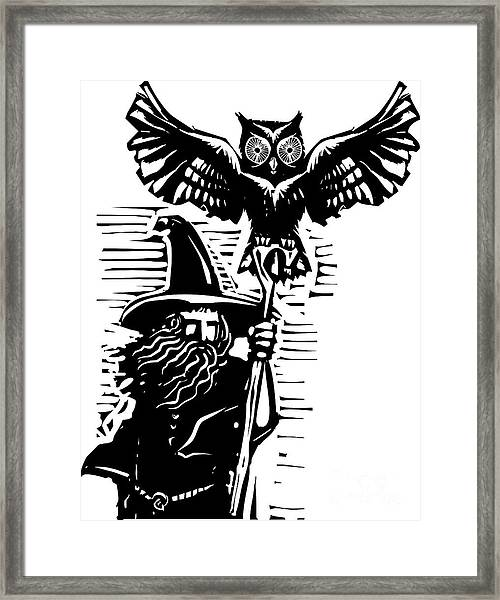 Woodcut Style Image Of A Wizard Holding Framed Print