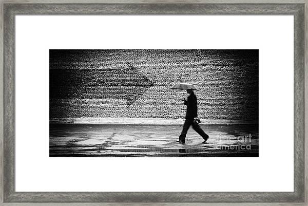 Wrong Way. A Man With Umbrella Framed Print