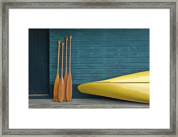Yellow Canoe And Paddles On Dock Framed Print by Mary Ellen Mcquay