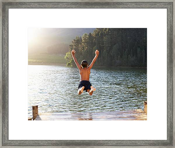 Young Boy Jumping Into Lake Framed Print