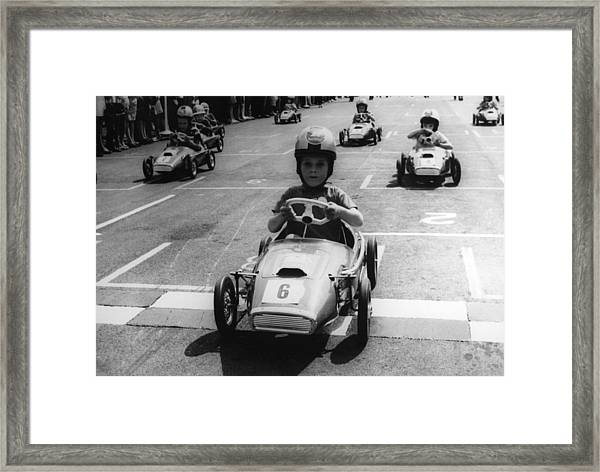 Young Boys Driving Racing Pedal Cars Framed Print