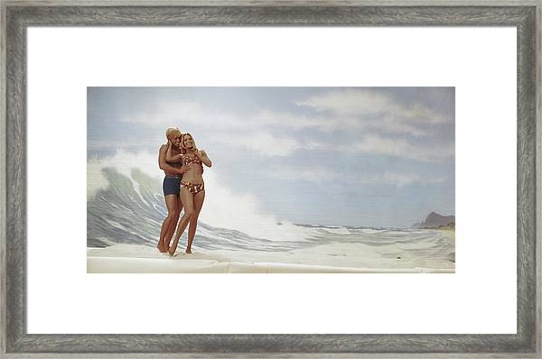 Young Couple Standing On Beach, Smiling Framed Print