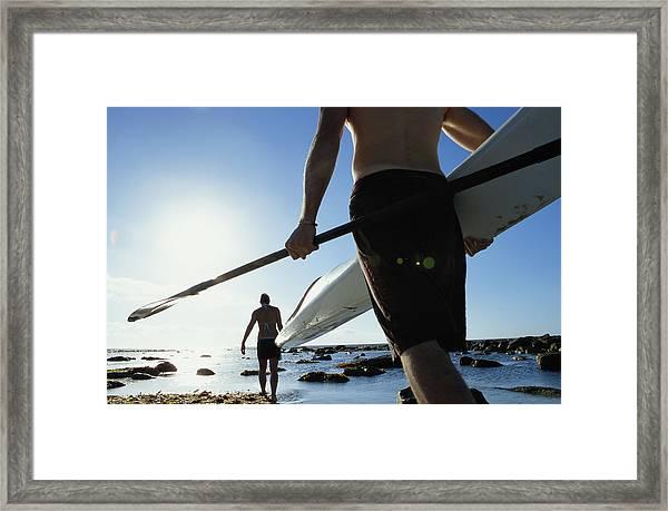 Young Couple Walking Towards Ocean, Man Framed Print