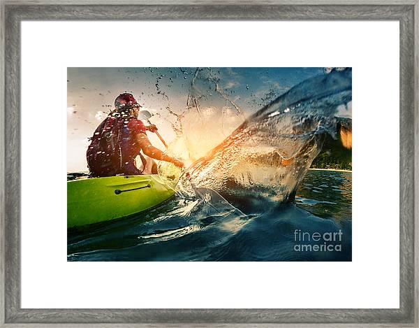 Young Lady Paddling Hard The Kayak With Framed Print by Dudarev Mikhail