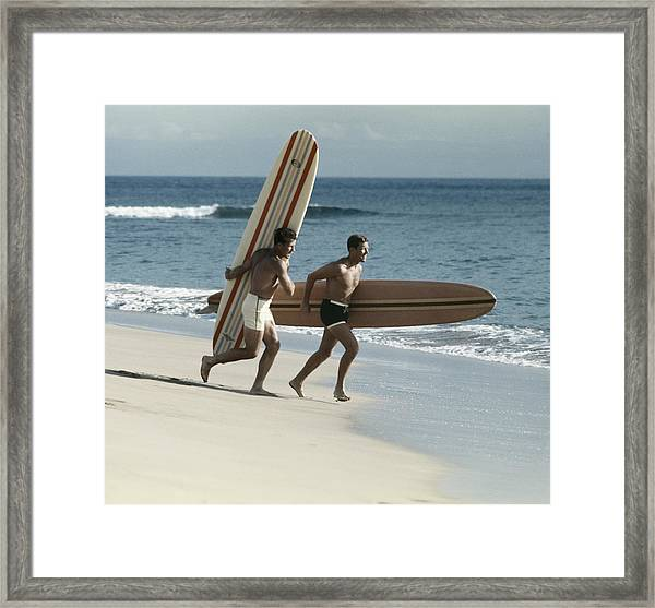 Young Men Running On Beach With Framed Print