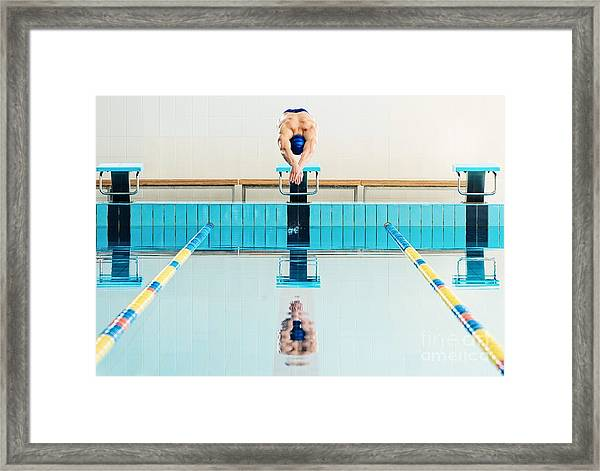Young Muscular Swimmer Jumping From Framed Print
