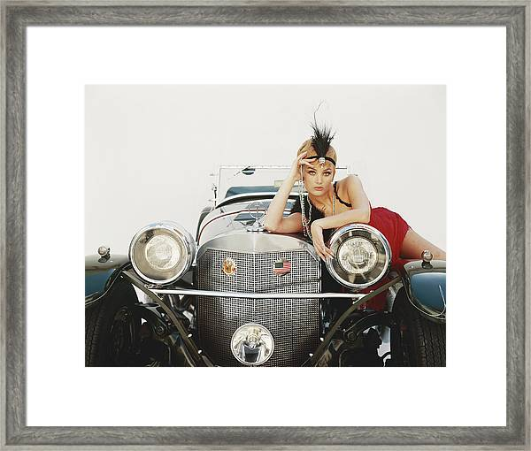 Young Woman Lying On Vintage Car Framed Print by Tom Kelley Archive