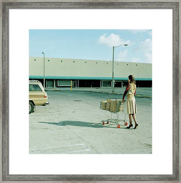 Young Woman Pushing Trolly Full Of Framed Print