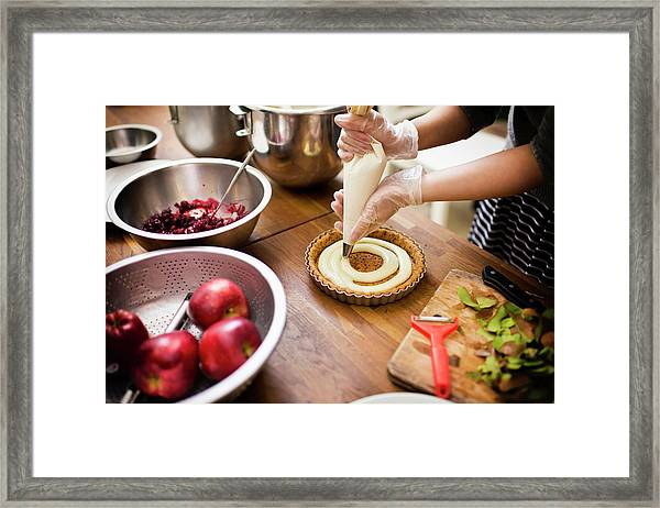 Young Woman Puts Custard On The Pies Framed Print by Leren Lu