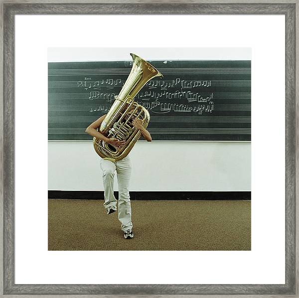 Young Woman Struggling To Hold Tuba In Framed Print