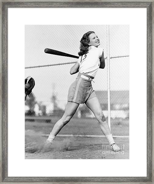 Young Woman Swinging A Baseball Bat In Framed Print