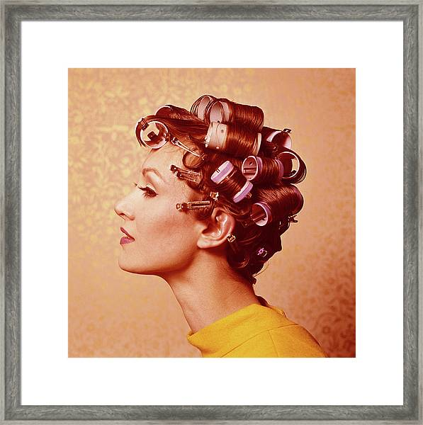 Young Woman Wearing Curlers, Profile Framed Print