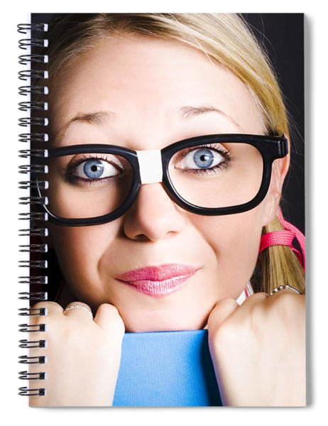 Face Of Smart Schoolgirl Holding Textbook On Black Spiral Notebook