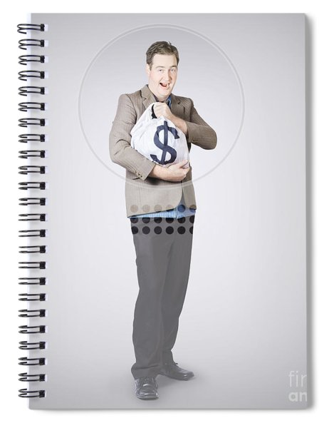 Surprised Business Man Holding Money Bag In Bank Spiral Notebook