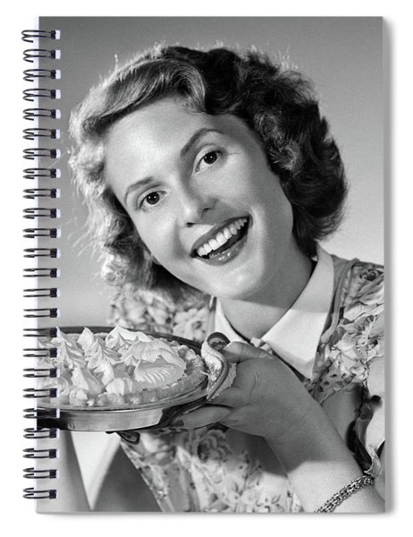 1950s Smiling Woman Presenting Holding Spiral Notebook