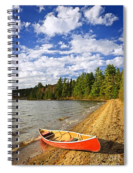 Red Canoe On Lake Shore Spiral Notebook by Elena Elisseeva