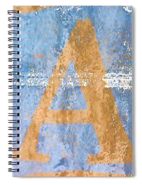 A In Blue Spiral Notebook