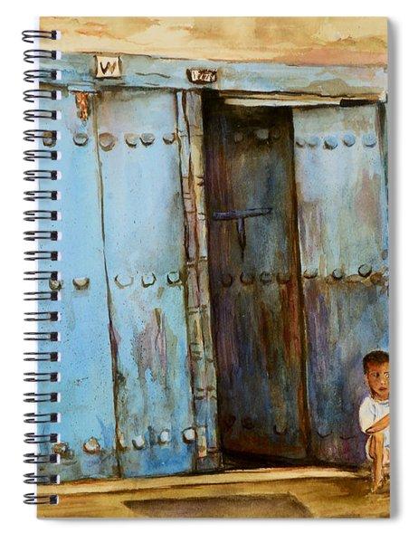 Child Sitting In Old Zanzibar Doorway Spiral Notebook